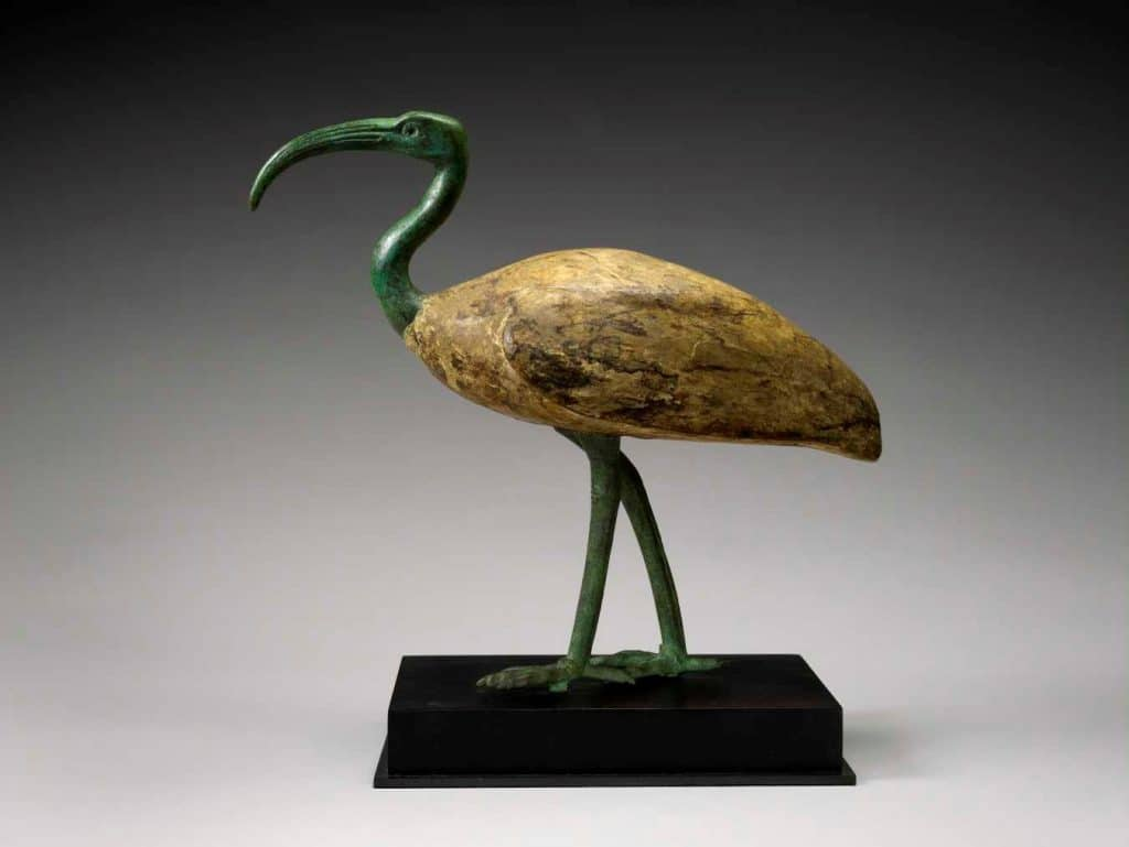 Ibis Sculpture: This unusually large ibis has elegant proportions and animation. He strides forth on long, powerful legs of cast bronze. His sharp-clawed feet and curved beak create an impression of strength and purpose. The cult of Thoth was especially popular in late Egyptian dynasties, leading to the creation of exceptional statues and amulets.